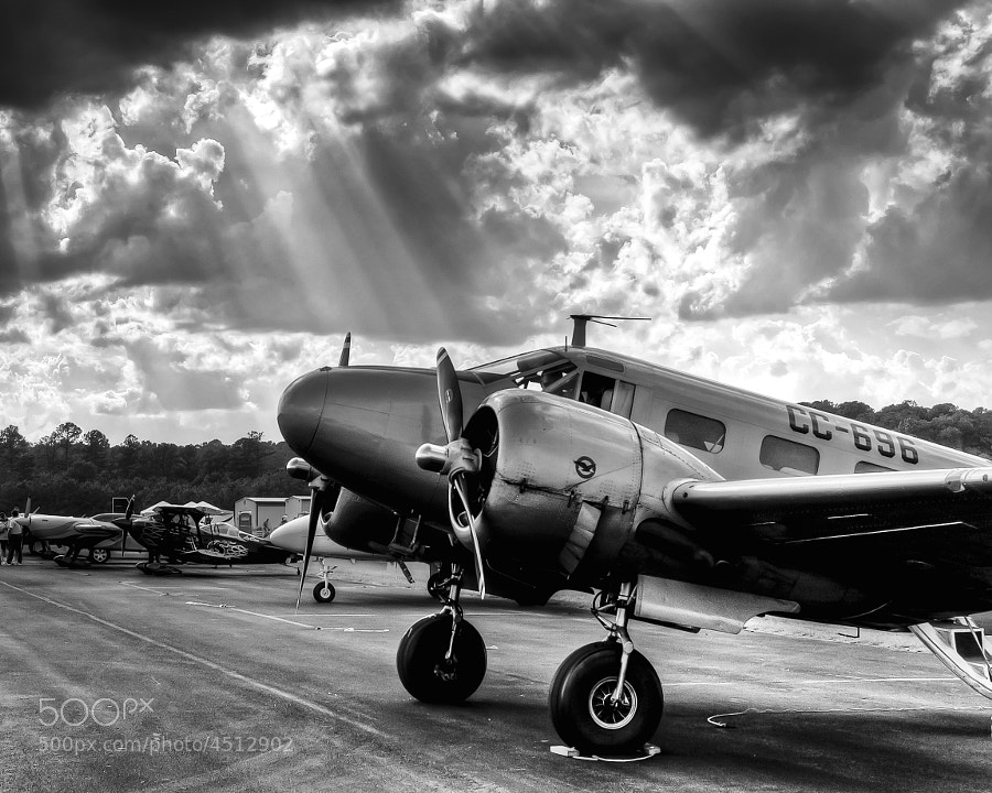 Rays of the sun punch through the clouds at the end of an airshow in Rome, Georgia.