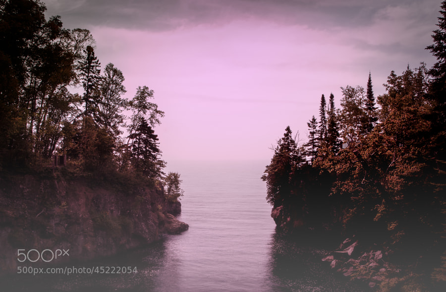The Temperance River flowing into Lake Superior on a misty morning.