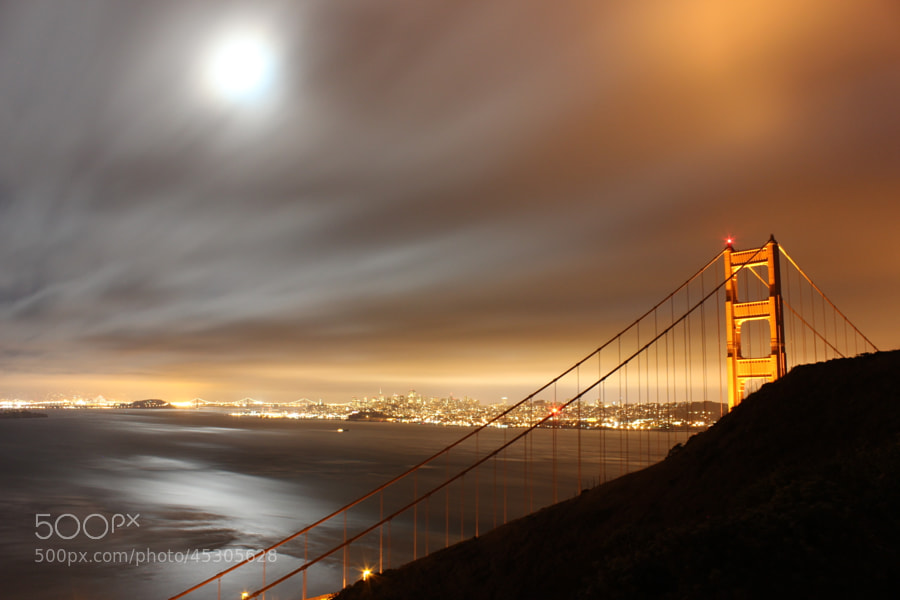 Mångata is the Swedish word for the road that the moon seemingly creates on a body of water. The conditions were ripe for this when the moon rise coincided with night time during the Sturgeon moon. This is mångata that can be seen with the Golden Gate Bridge in the foreground and the San Francisco Bay and city in the background.