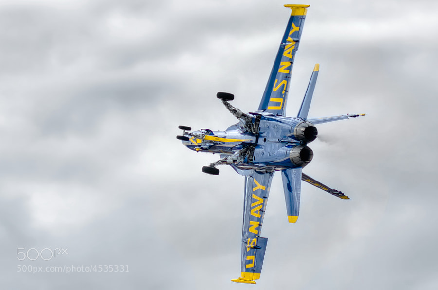 "Blue Angel solo aircraft #5 performs a ""dirty roll"" on takeoff at NAS Pensacola"