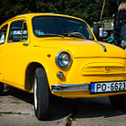 Постер, плакат: a small yellow car ZAZ