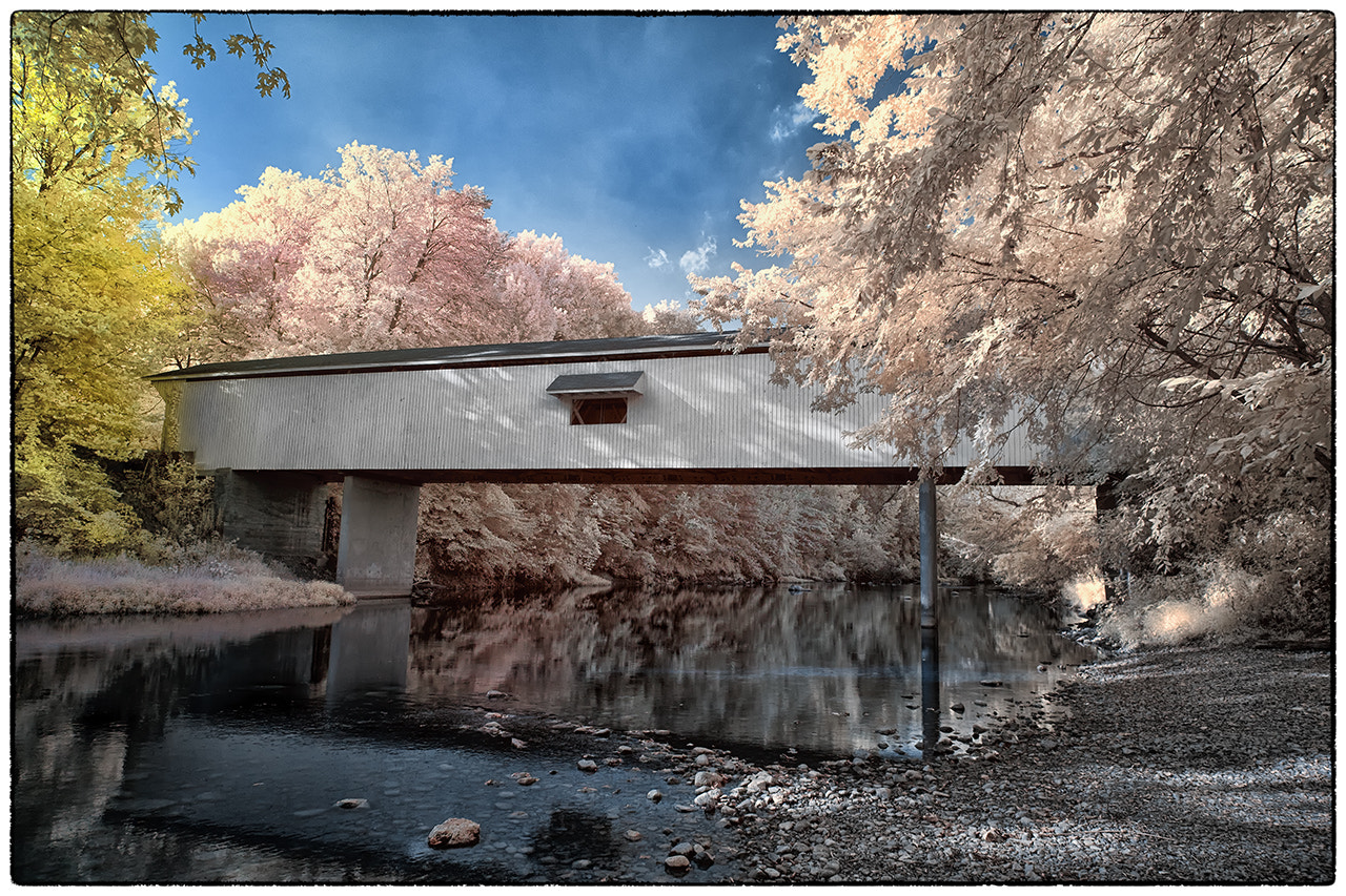 Photograph Adams Mill Covered Bridge, 720nm IR by James Hilliard on 500px