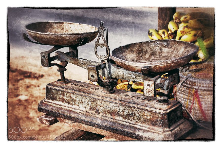 A street vendors scales at a fruit and vegetable stand. Madagascar