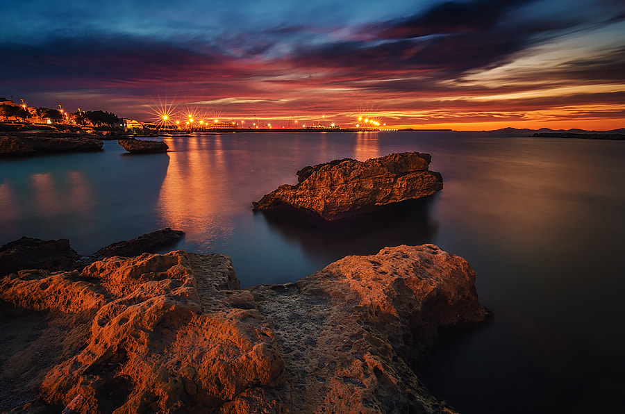 Photograph Red sunset in Porto Torres by Fabrizio Lutzoni on 500px