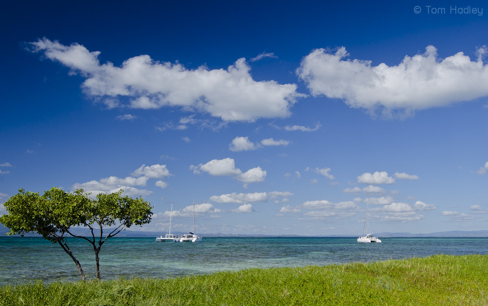 Photograph Catamarans moored off Cayo Blanco by Tom Hadley on 500px