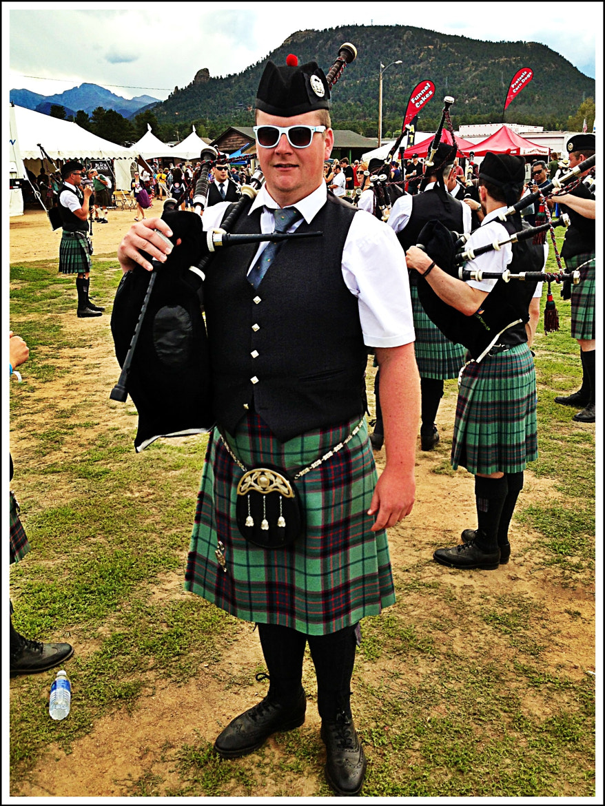 Photograph Sunglassed Bagpiper by James Herzog on 500px