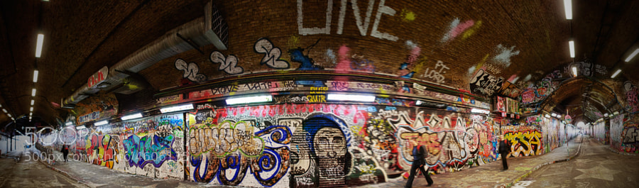 "the Leake Street subway aka ""Banksy Tunnel"" is close to the Waterloo station and decorated with graffiti"