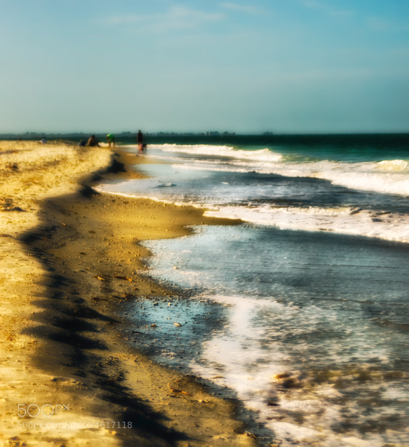 The beach at Treasure Island, FL, USA. This is one photo that I manipulated to look impressionistic.