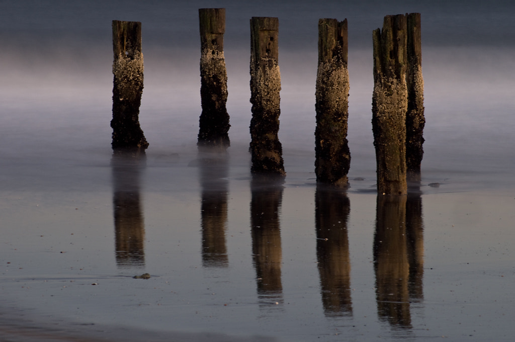 Photograph Pier Ruins Relfected by Dave Rogers on 500px