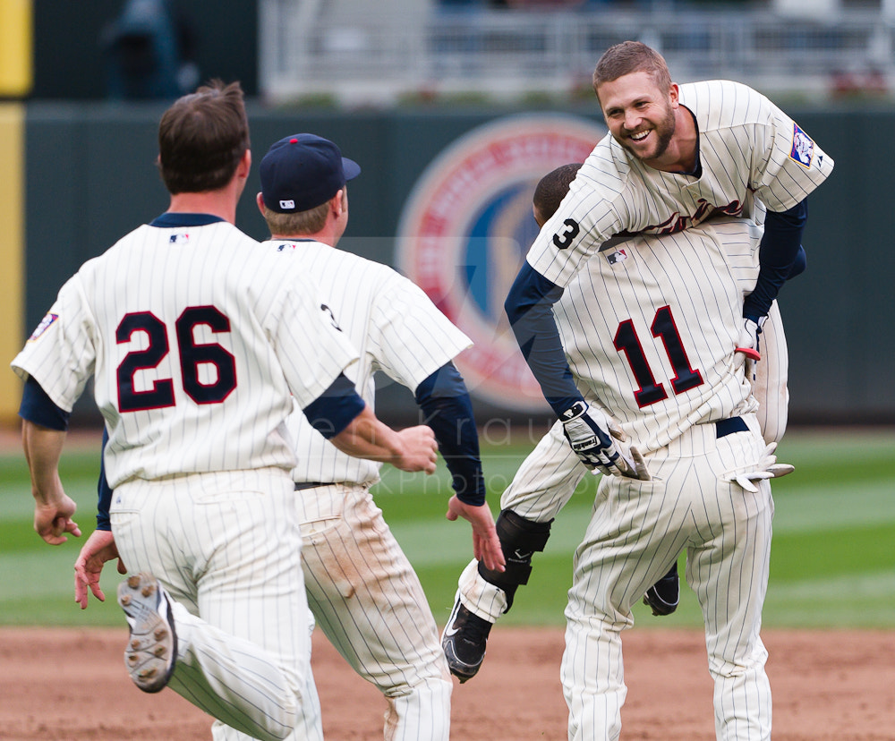 Photograph Minnesota Twins Rene Tosoni, Walk-off Win, September 22, 2011 by Ben Krause on 500px