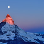 First ray of light on the Matterhorn under the Harvest Moon.
