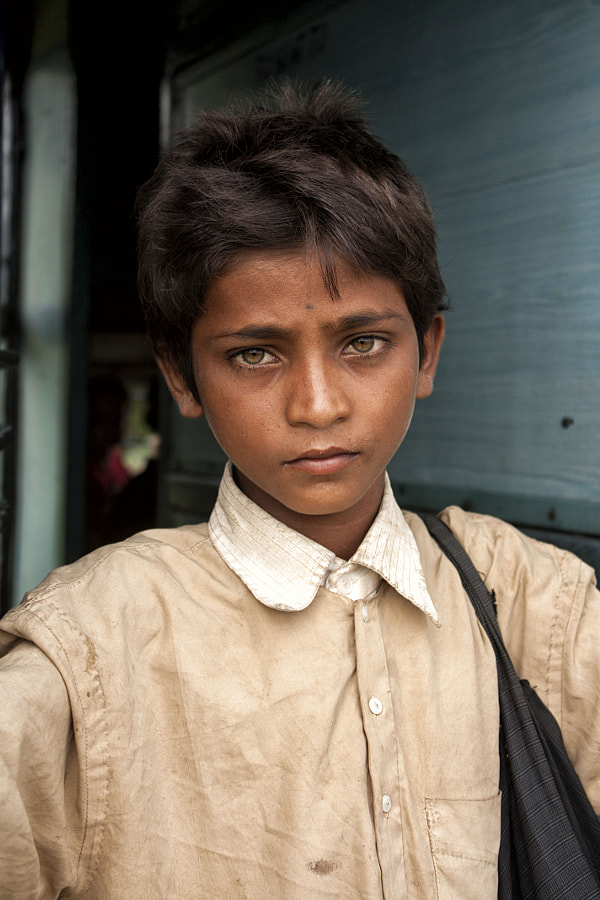 Indian child portrait, on the way to Varanasi, India by Abdellatif Snoussi