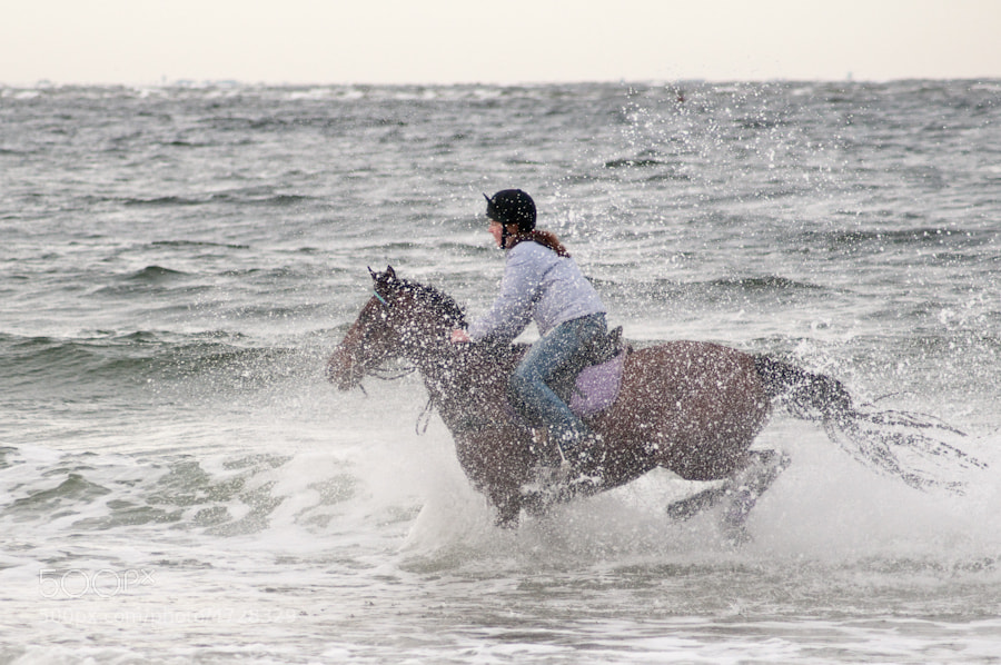 Photograph Rider in the surf by Paul Mozell on 500px