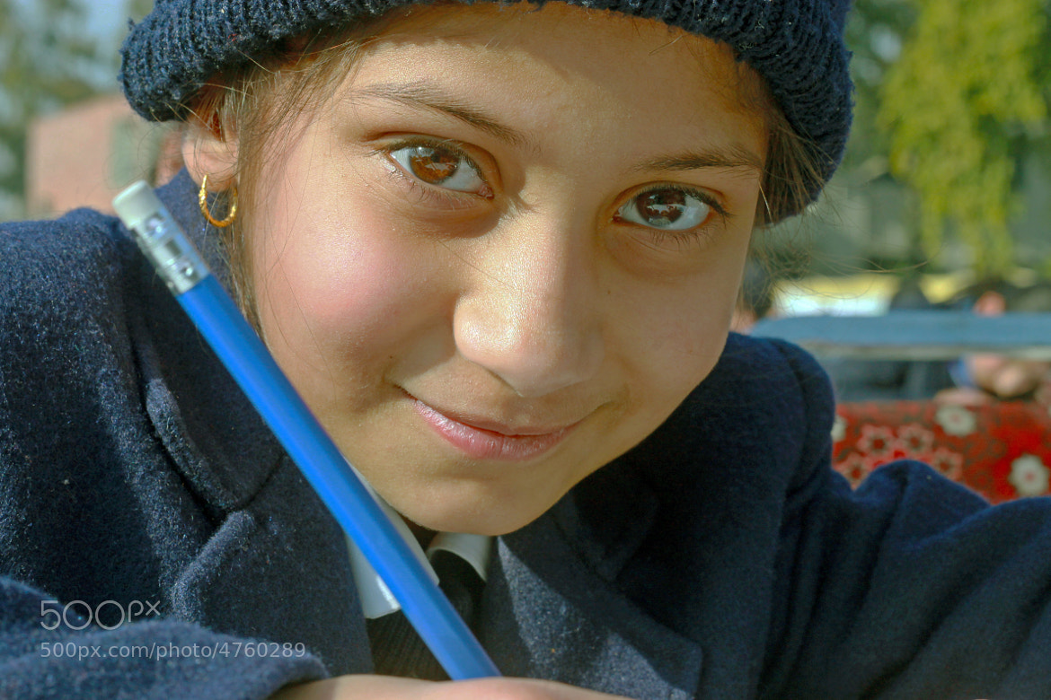 Photograph Controlled smile by hasnain raza on 500px