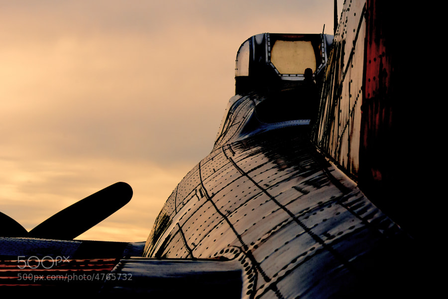 "The setting sun casts a warm glow on the side of the B-17G Flying Fortress ""Aluminum Overcast"""