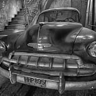 old car in one of the rare garages in historic Havana.