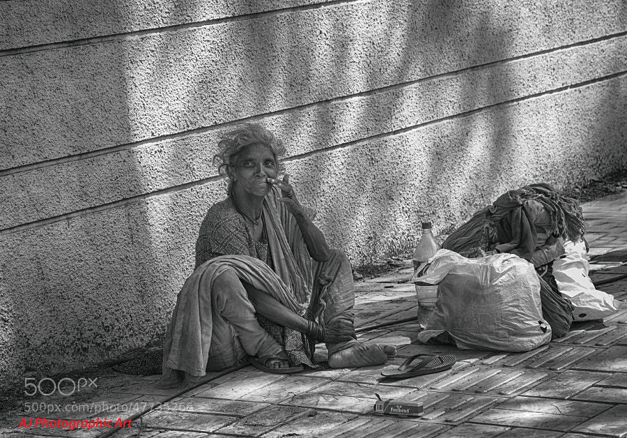 Digital black & white image of homeless woman on the streets of India (Indore, India)