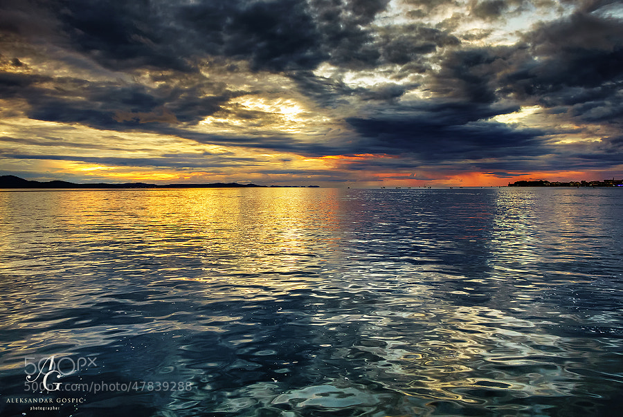 Watercolored evening in the Zadar Channel, while the clouds of cyclone Olivia are slowly breaking in the west