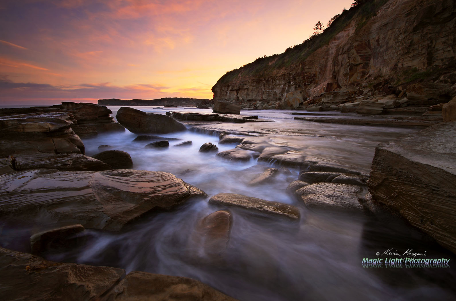 Photograph Skillion Rocks at Sunset by Kevin Morgan on 500px