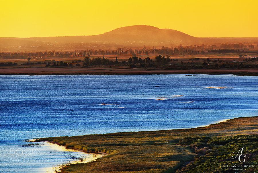 Sunset above the Bura wind wrinkled Vransko jezero (Vrana lake)