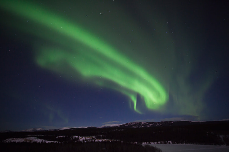 Photograph Aurora above the Yukon River by Nicolas Dory on 500px