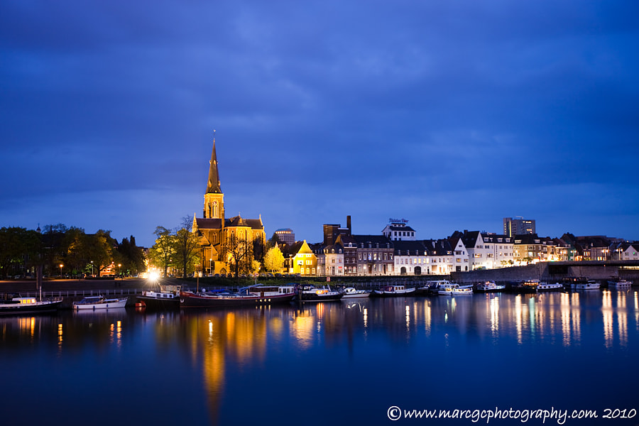 "Join me on my <a href=""https://www.facebook.com/marcgcphotography"" rel=""nofollow"">Facebook Page</a>.  Maastricht is one of the oldest cities of in Netherlands, a few years ago I had the opportunity to do a brief walk around the Maas River. It was almost dark and the sky was really blue, it was raining a little bit but I finally manage to get some shoots like this one."