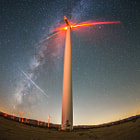 Постер, плакат: Meteor milky way and wind turbine