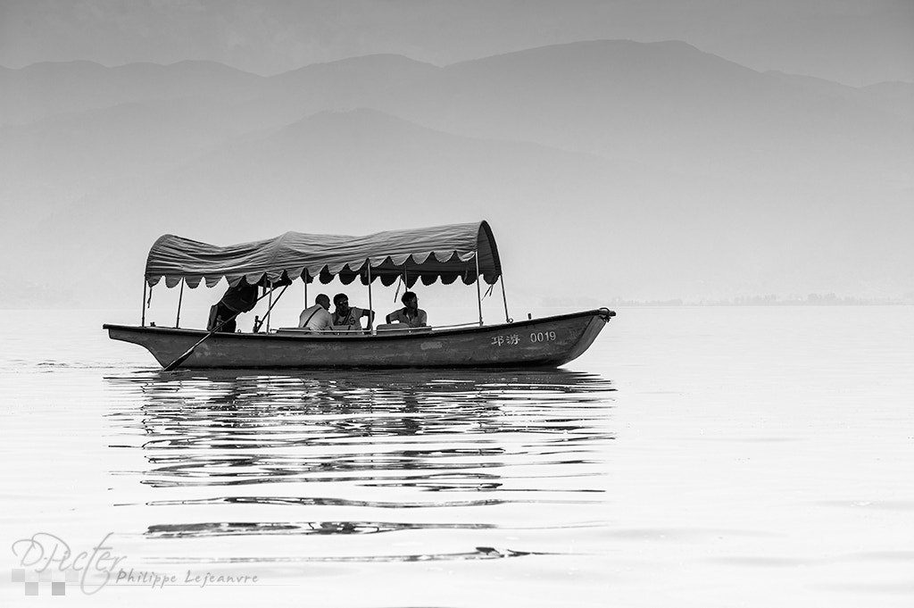 Photograph Small boat on qionghai lake by Philippe Lejeanvre on 500px