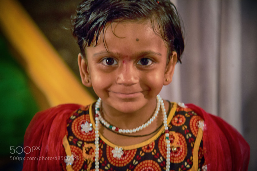 Digital color image of young girl in decorative outfit at the Navratri ('Nine Nights') Festival in Indore, India