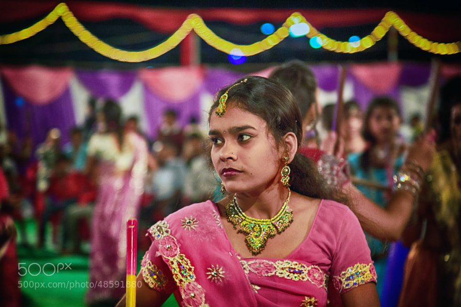 Digital color image of young lady dancer dressed in pink decorative outfit at the Navratri Festival (Indore, India)