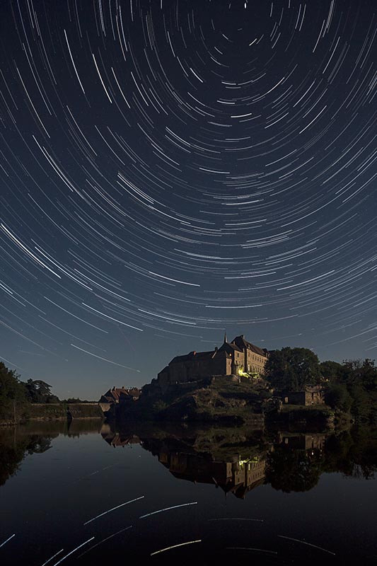 Photograph Star trail over the Benedictine Priory at Saint Benoît du Sault by Jeff Morgan on 500px