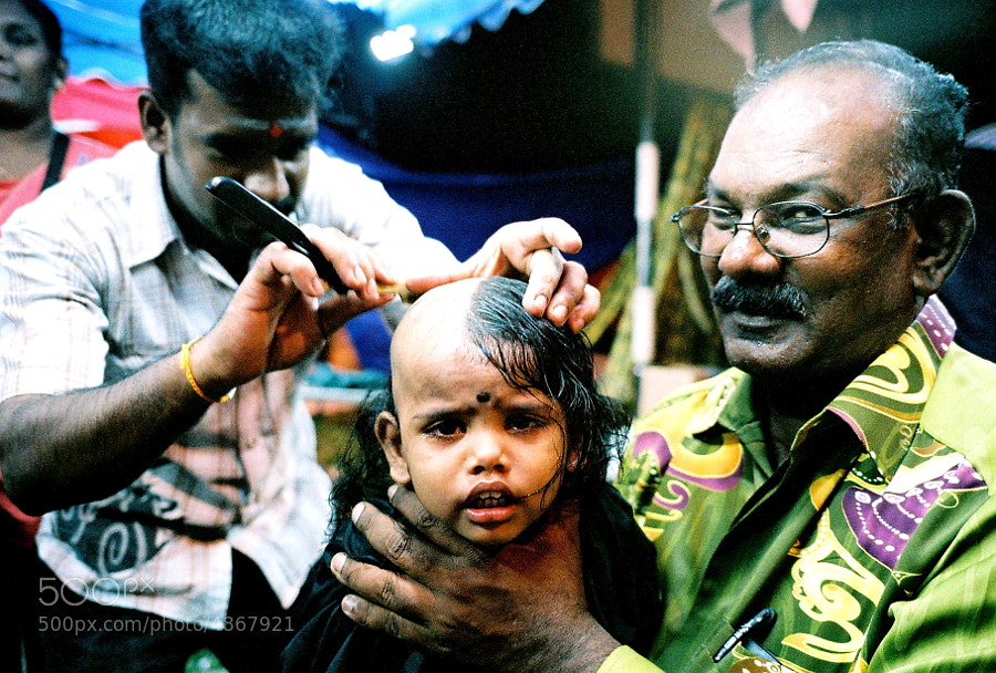 """During Thaipusam, some devotees who may choose to tonsure their head, which is also another common vow.   **Thaipusam (Tamil: தைப்பூசம், Taippūcam ?) is a Hindu festival celebrated mostly by the Tamil community on the full moon in the Tamil month of Thai (January/February). It is celebrated not only in countries where the Tamil community constitutes a majority, but also in countries where Tamil communities are smaller, such as Mauritius[1], Singapore[2] and Malaysia.[3] The word Thaipusam is derived from the month name Thai and Pusam, which refers to a star that is at its highest point during the festival. The festival commemorates the occasion when Parvati gave Murugan a vel """"spear"""" so he could vanquish the evil demon Soorapadam. There is a misconception among people that Thaipusam marks Murugan's birthday; however, it is believed that Vaikhasi Vishakam, which falls in the Vaikhasi month (May/June), is Murugan's birthday."""