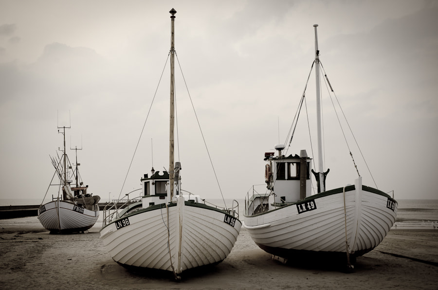 Photograph Fishing boats on the beach by Jette Vad on 500px