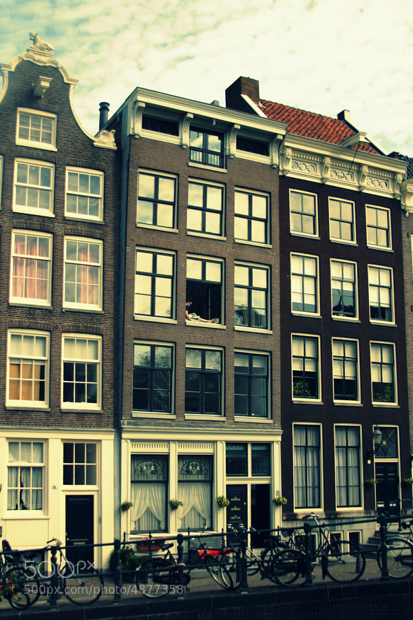 This was shot in the Jordaan district. That girl sitting there at her window struck me as i recognised myself in her. Had to let the camera talk. She fits so perfectly in the building. Sometimes all it takes is 5 seconds...