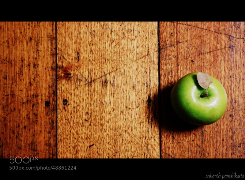 Photograph Apple and the wooden floor by Srikanth Panchikarla on 500px
