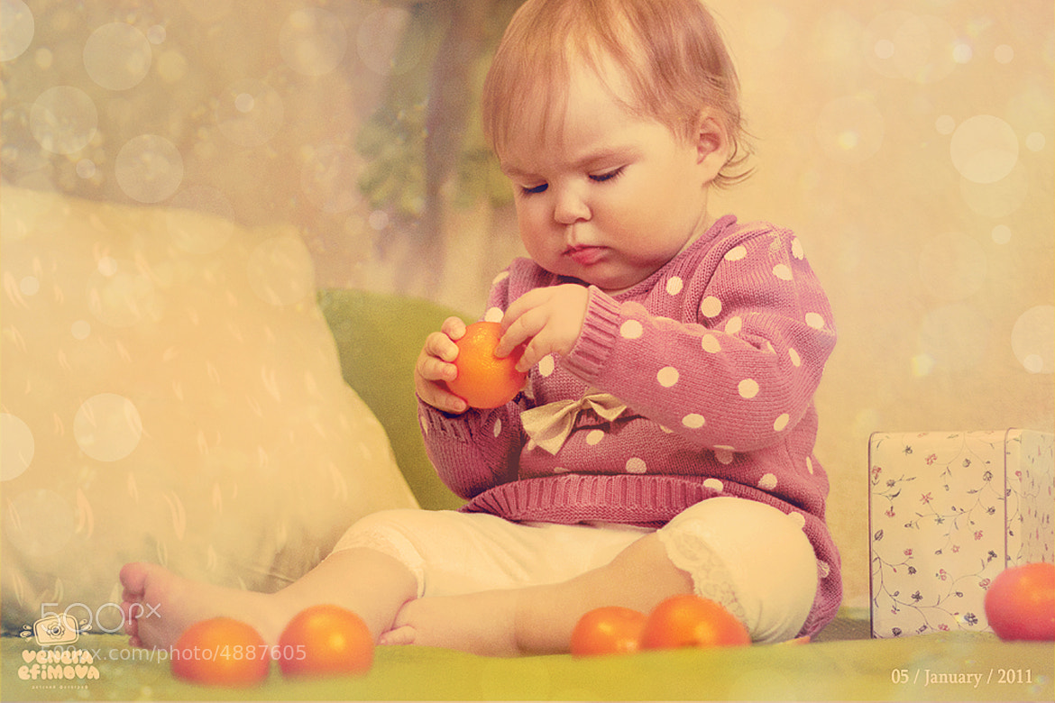 Photograph Learn to clean mandarin =) by Venera Efimova on 500px