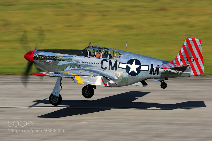 The Collins Foundation P-51C Mustang landing at my local airport.