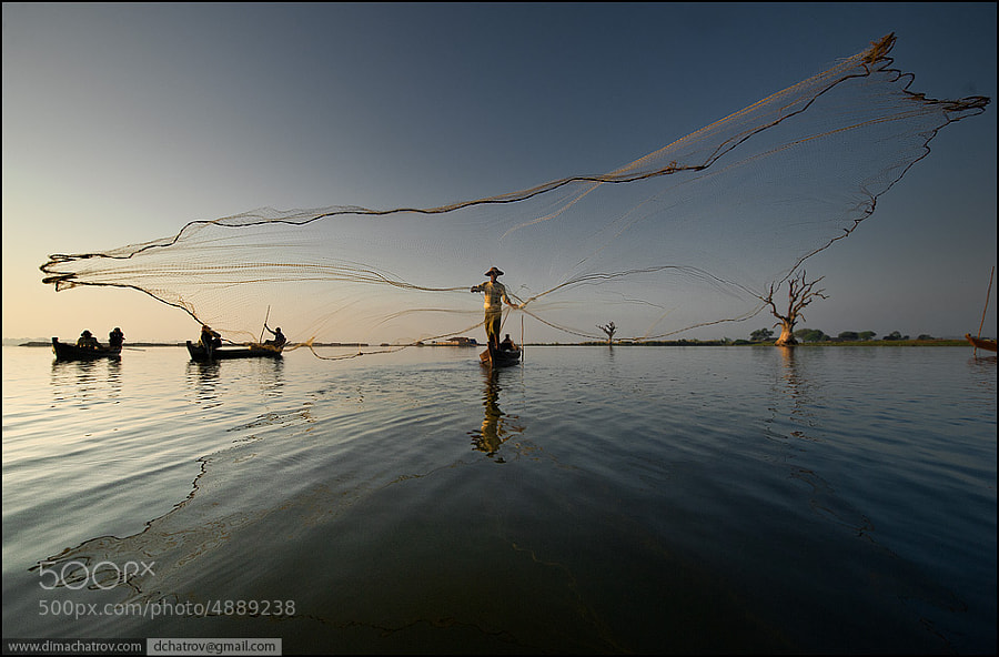 "There is one more shot from Myanmar reality. Those guys are fishing with these type of ""spyder nets"" on every day basis like their grandfathers did, trying to catch something for families..."