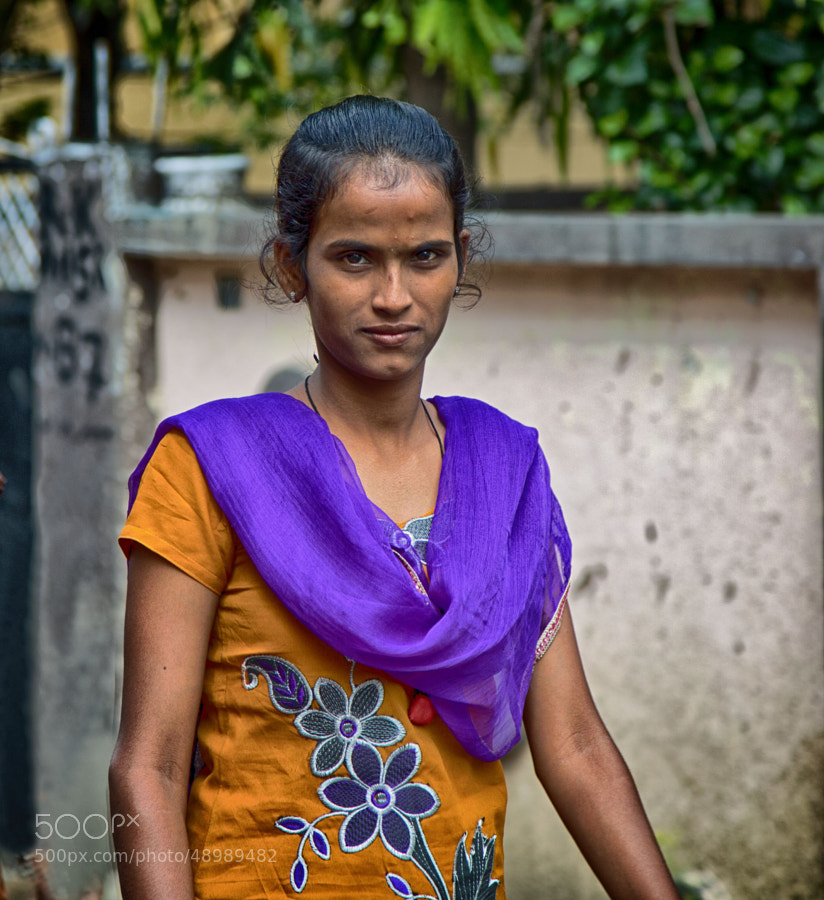 Digital color image of a young woman in an alley (Indore, India)