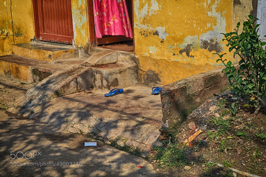 Digital color HDR image of blue sandals on a sunlit doorstep (Indore, India)