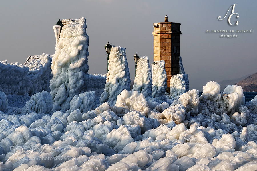 After two weeks of constant gale and hurricane force Bura wind, pier in Senj is covered with thick layer of salty ice