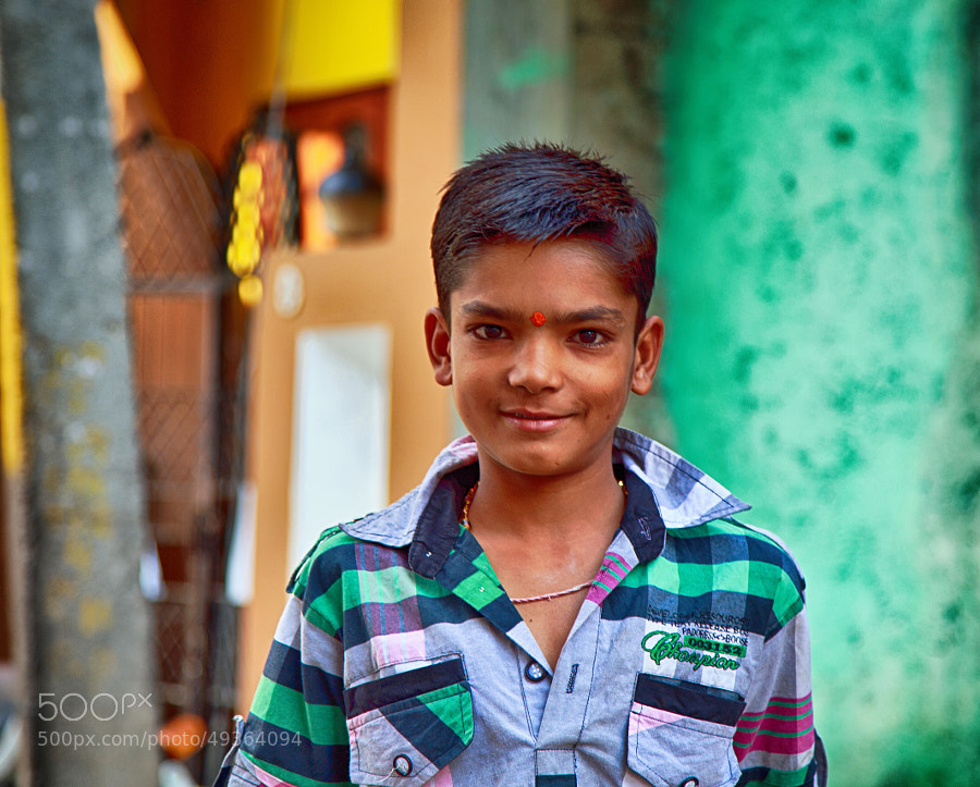 Digital color image of young boy on a side-street (Indore, India)