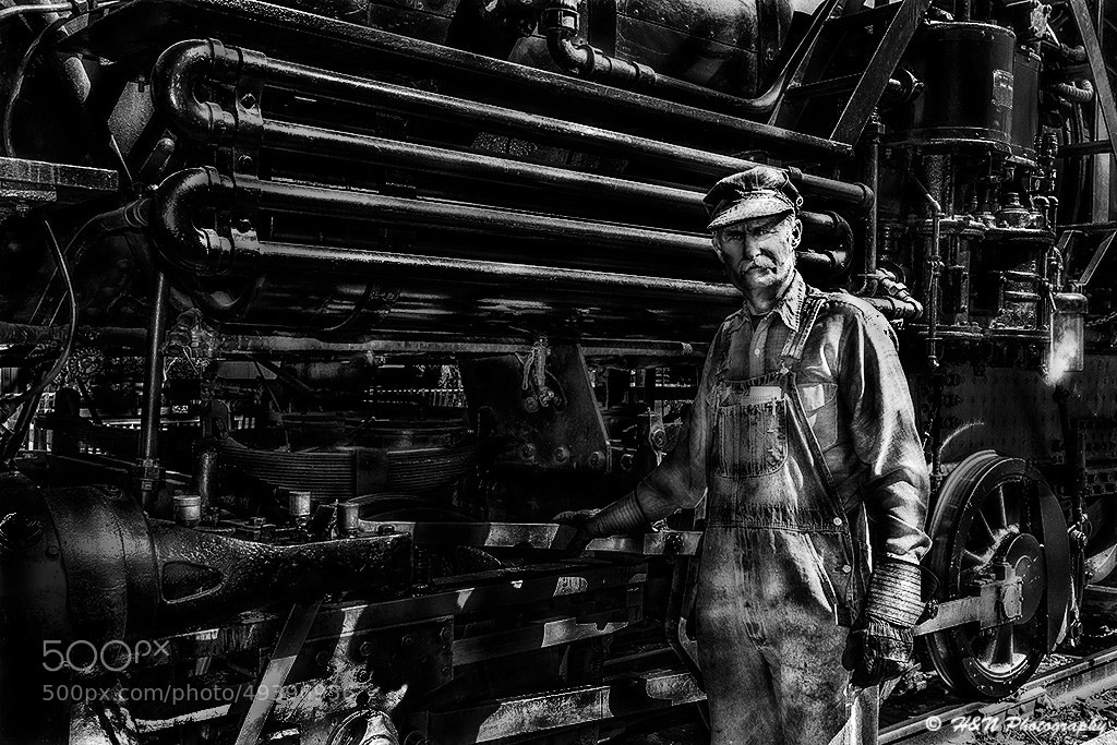 Photograph The Mechanic and his train by Henry Nguyen on 500px