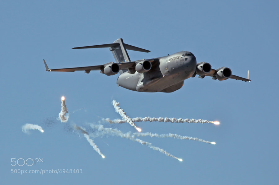 C-17A Globemaster III was photographed dispensing Flares and Chaff used to defeat SAMs, Surface-to-Air Missiles.
