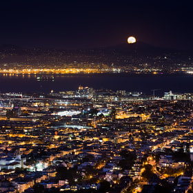 Full moon rising above Mount Diablo and overlooking the Mission district of San Francisco.