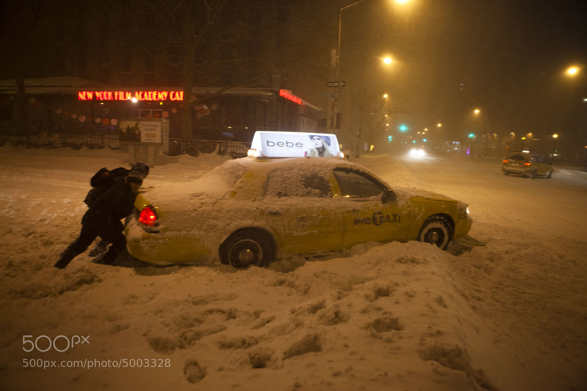 Photograph Taxi vs. Blizzard by Dan Nguyen on 500px