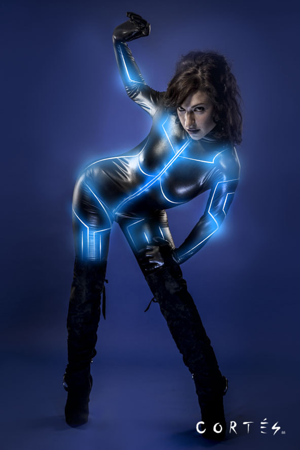 Photograph Young sexy latex woman on future costume, blue neon lights by Fernando Cortés  on 500px