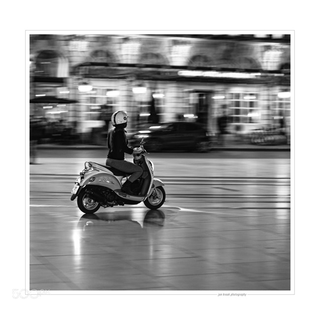 A scooter driving past at the Grand Theater in Bordeaux