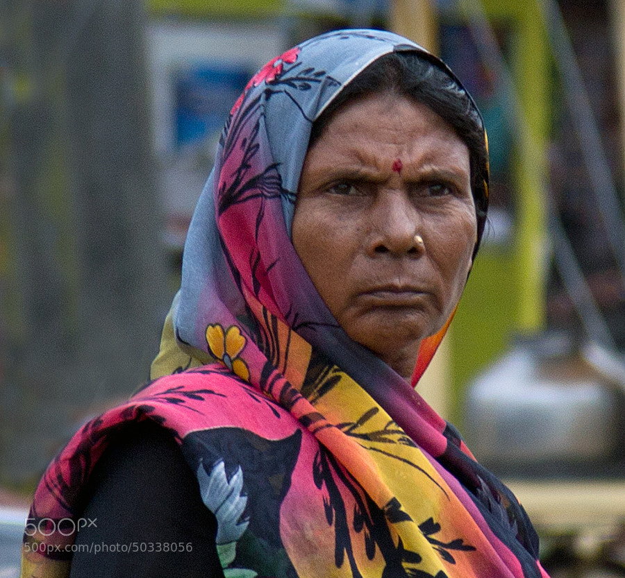 Digital color close-up image of a woman' face at the marketplace in Indore, India