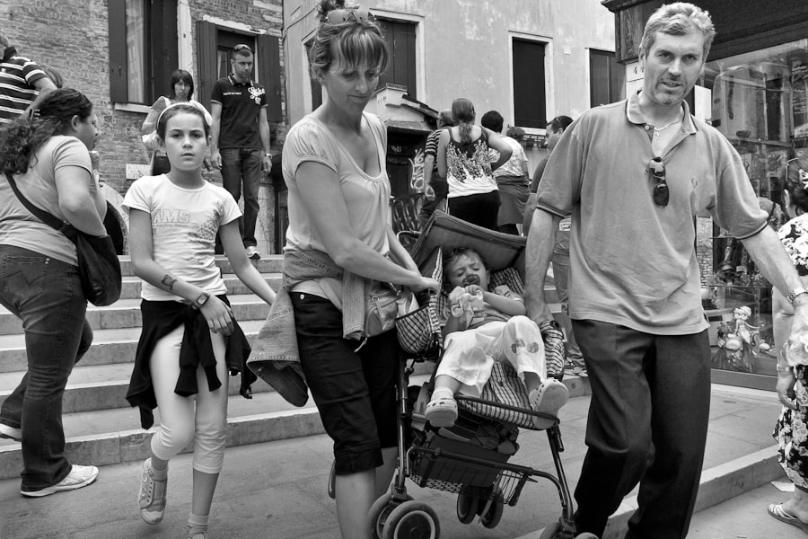 Photograph Couple carrying pram - Venice by Byron Edwards on 500px